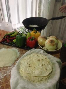 The tortillas cooking in the wok.